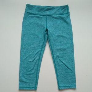 Ivivva rhythmic crop Leggings in turquoise
